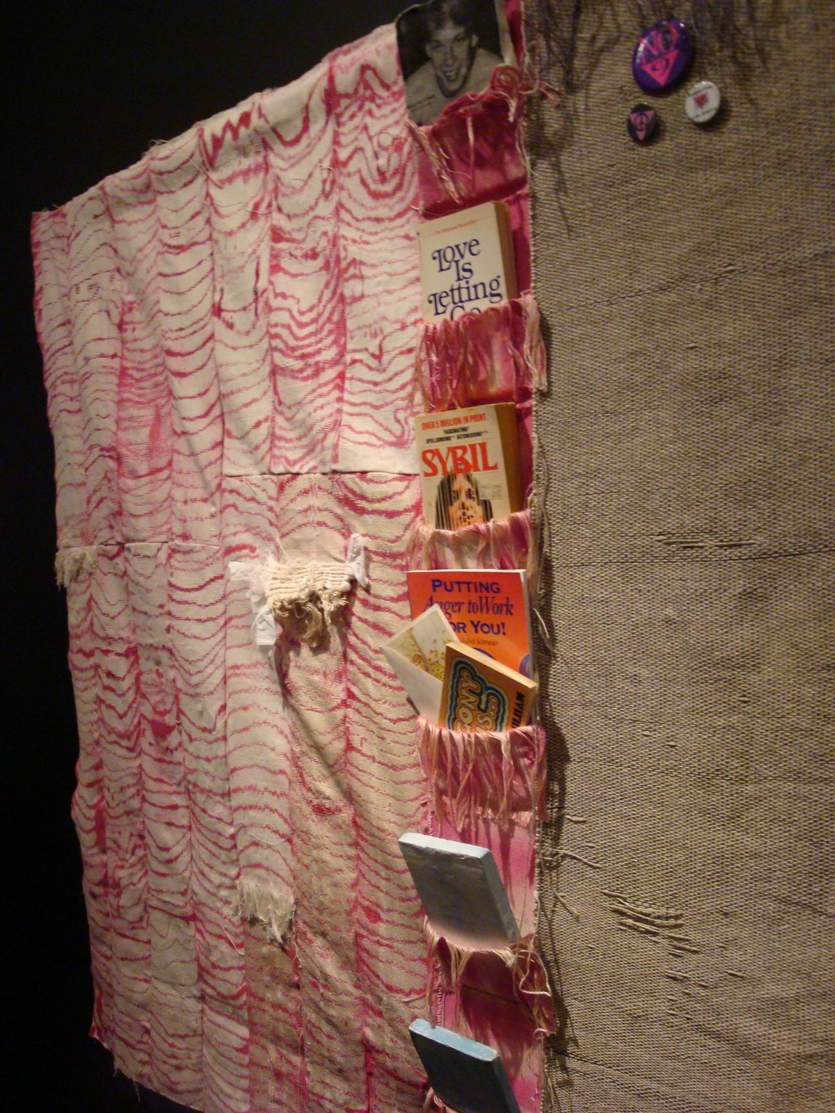 Josh Faught's Triage, mixed media of canvas hemp, books, stitched and hung  together.
